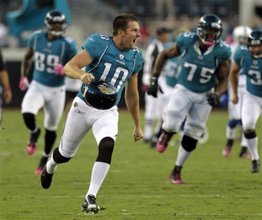 Jacksonville Jaguars placekicker Josh Scobee (10) celebrates as he runs down the field chased by teammates after kicking a game-winning field goal to defeat the Indianapolis Colts 31-28 in an NFL football game in Jacksonville, Fla., Sunday, Oct. 3, 2010. (AP Photo/John Raoux)