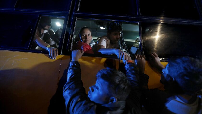TIJUANA, MEXICO. - NOV. 16, 2018. A busload of Central American immigrants arrives at the Benito Ju