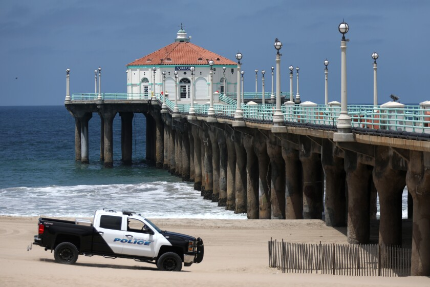Manhattan Beach police patrol near the pier on July 3.