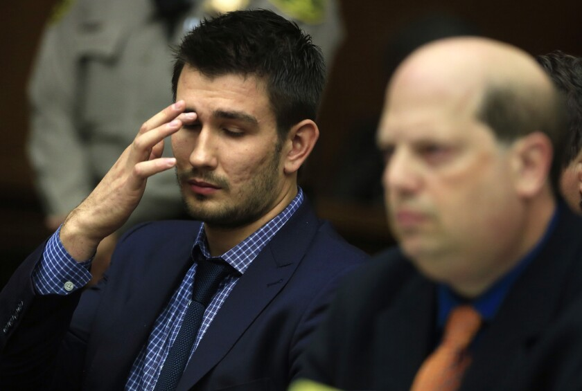 Kings defenseman Slava Voynov, left, attends his arraignment last December in Los Angeles County Superior Court in Torrance.