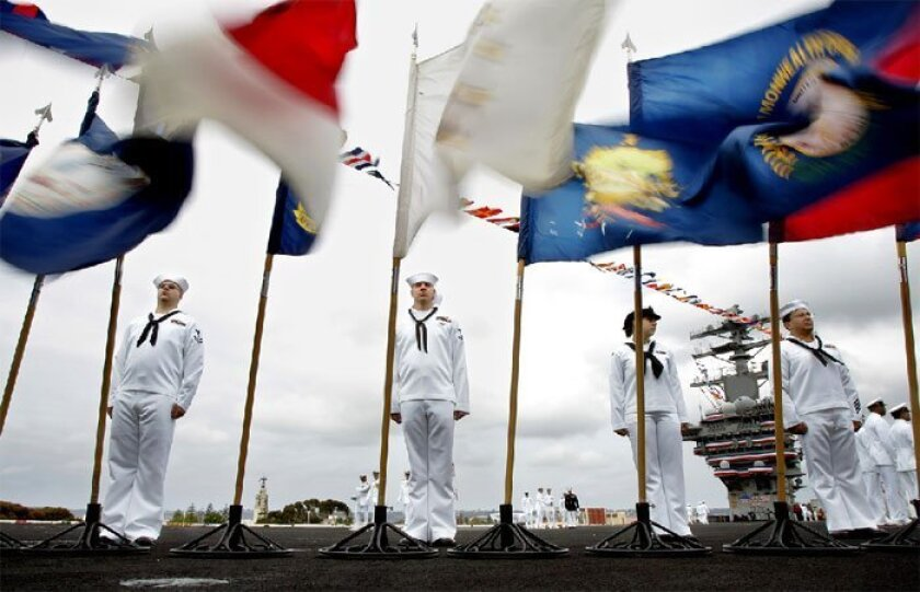 Sailors lined the flight deck of the aircraft carrier Nimitz at North Island Naval Air Station at the beginning of  the 3rd Fleet change-of-command ceremony on June 13, 2009. (Eduardo Contreras / Union-Tribune)