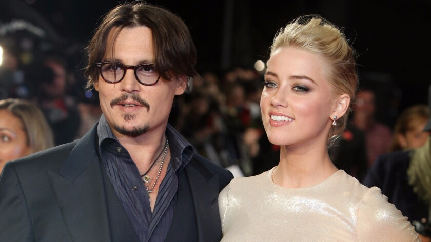 "Actors Johnny Depp, left, and Amber Heard attend ""The Rum Diary"" premiere in London on Nov. 3, 2011."