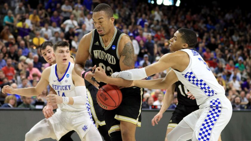 Wofford's Cameron Jackson (33) fights for the ball against Kentucky's Tyler Herro (14) and Keldon Johnson (3) during the second half of the second round of the NCAA tournament on Saturday in Jacksonville, Fla.