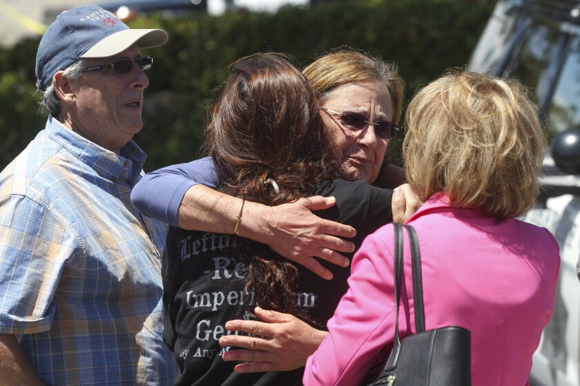 Chabad of Poway members gather outside their synagogue after a man shot multiple people on April 27, killing one.