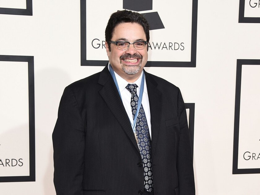 """FILE - In this Feb. 8, 2015 file photo, Arturo O'Farrill arrives at the 57th annual Grammy Awards in Los Angeles.  O'Farrill is nominated for two Grammys, one for large jazz ensemble album for """"Cuba:The Conversation Continues,"""" and best instrumental composition for """"The Afro Latin Jazz Suite."""" (Pho"""