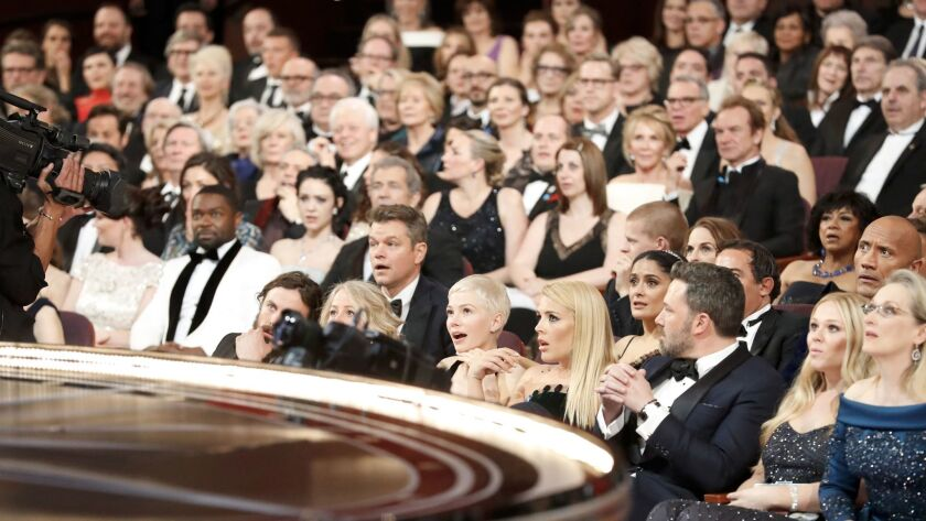 "The audience at the Academy Awards is stunned after realizing that ""La La Land"" was mistakenly announced as best picture. The actual winner was ""Moonlight."" http://lat.ms/2m3Wtny"