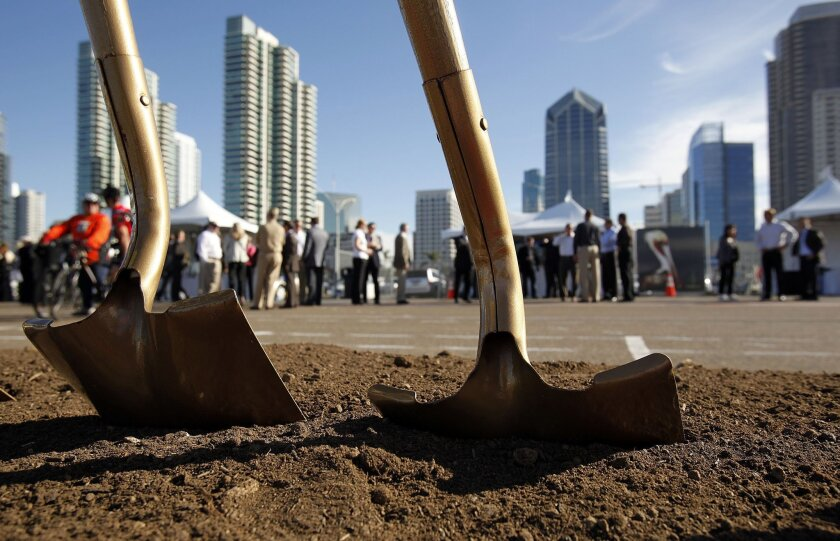 Shovels stand in ground before groundbreaking of the North Embarcadero Visionary Plan's first phase.
