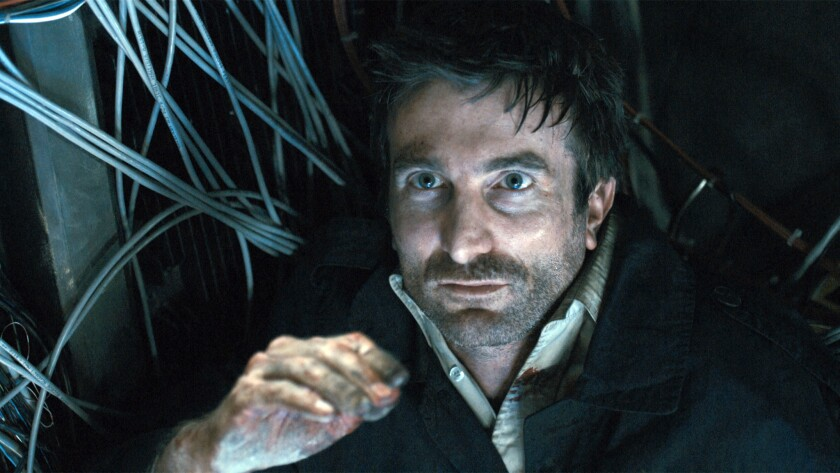 """Sharlto Copley in the sci–fi thriller """"District 9."""""""