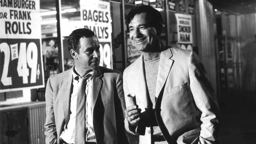 """FILE––Walter Matthau, right, and Jack Lemmon stroll down New York's Broadway during the filming of """""""