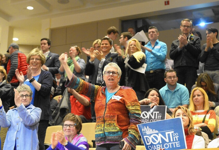 People cheer a Charlotte, N.C., City Council vote on transgender protections.