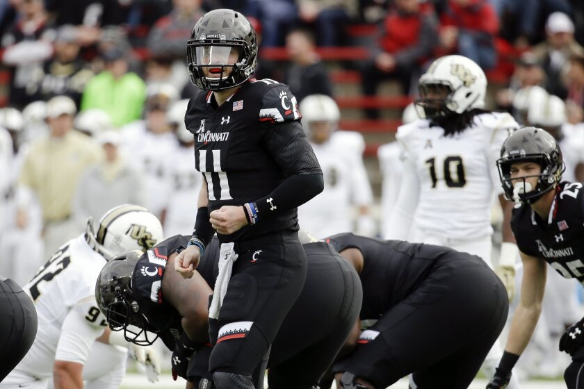 Cincinnati quarterback Gunner Kiel (11) looks over to his sideline before a play in the first half of an NCAA college football game against UCF, Saturday, Oct. 31, 2015, in Cincinnati. (AP Photo/John Minchillo)