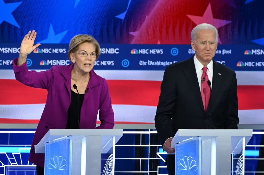 Sen. Elizabeth Warren and former Vice President Joe Biden onstage in presidential primary debate