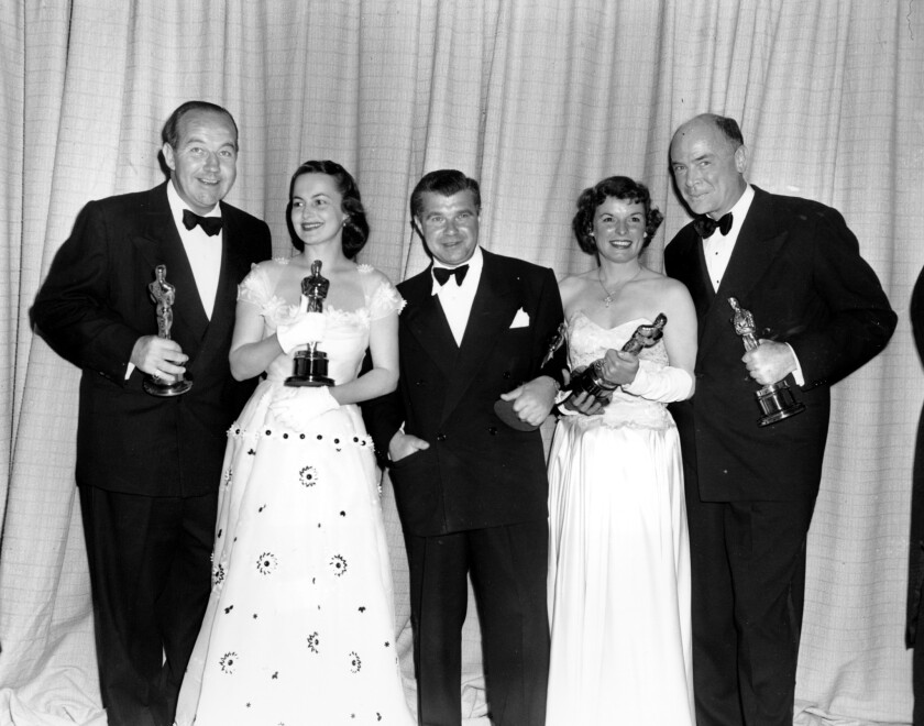 Broderick Crawford, left, Olivia de Havilland, Robert Rossen, Mercedes McCambridge and Dean Jagger at the 22nd Annual Academy Awards ceremony on March 23, 1950.