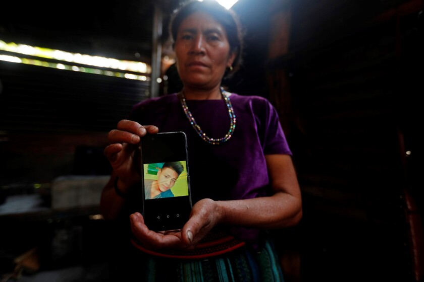 Rigoberta Vasquez with a photo of her 16-year-old son, Carlos Hernandez Vásquez, in her house in the San Jose del Rodeo village, in Cubulco, Baja Verapaz, Guatemala. Carlos died Monday.