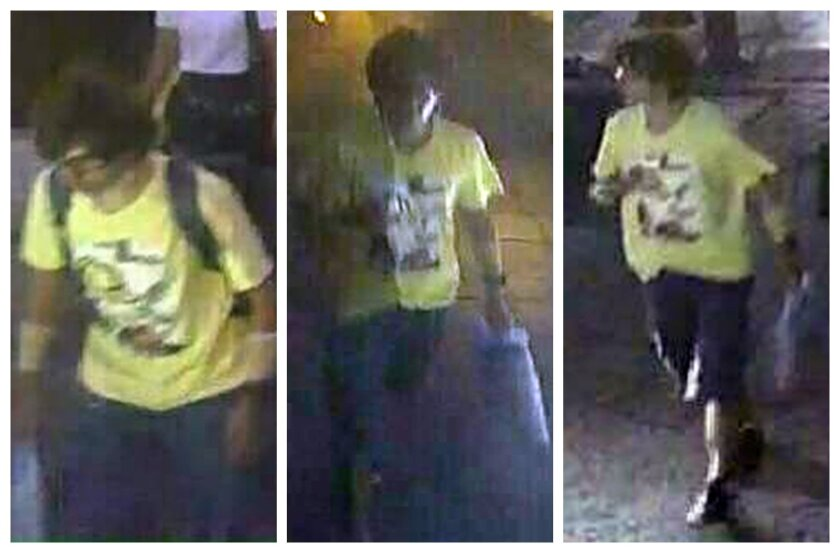 """FILE - In this Aug. 17, 2015 file image, released by Royal Thai Police spokesman Lt. Gen. Prawut Thavornsiri shows a man wearing a yellow T-shirt near the Erawan Shrine before an explosion occurred in Bangkok, Thailand. National police chief Somyot Poompanmoung said Monday, Aug. 24,2015, that police were trying to """"put pieces of the puzzle together"""" but had to use their imagination to fill holes where street-side security cameras were broken and unable to record the suspect's movements. (Royal Thai Police via AP, File)"""