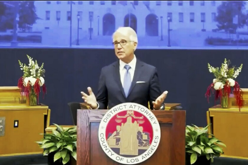 In this photo from the County of Los Angeles streaming video, incoming Los Angeles County District Attorney George Gascon speaks after he was is sworn in in downtown Los Angeles Monday, Dec. 7, 2020. Gascon, who co-authored a 2014 ballot measure to reduce some nonviolent felonies to misdemeanors, has promised more reforms to keep low-level offenders, drug users, and those who are mentally ill out of jail and has said he won't seek the death penalty. (County of Los Angeles via AP)