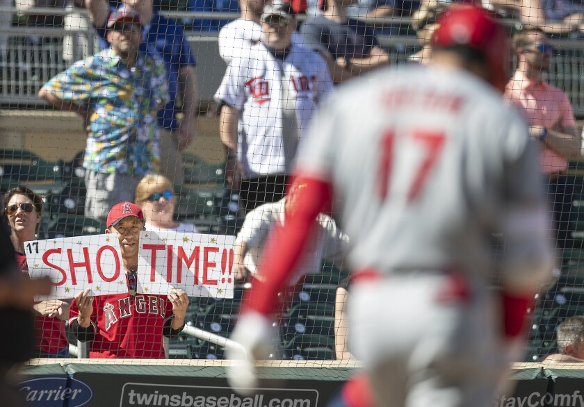A fan shows his support for Angels designated hitter Shohei Ohtani during a game against the Minnesota Twins on May 15.