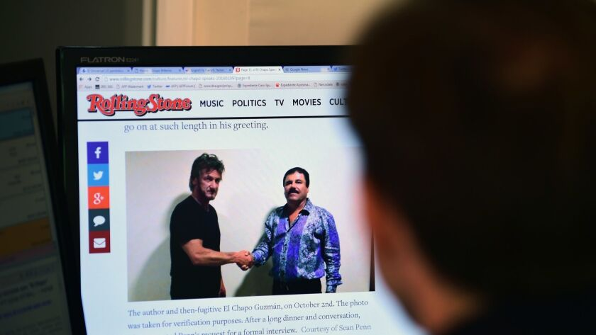 """A man reads an article about drug lord Joaquin """"El Chapo"""" Guzman, who was interviewed by actor Sean Penn for Rolling Stone magazine. Portions of that interview were played at Guzman's trial Tuesday."""