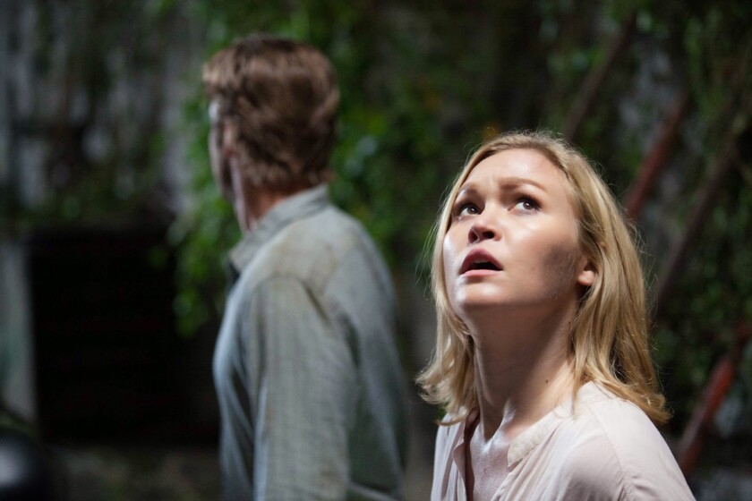 """Julia Stiles, right, and Scott Speedman in """"Out of the Dark."""""""