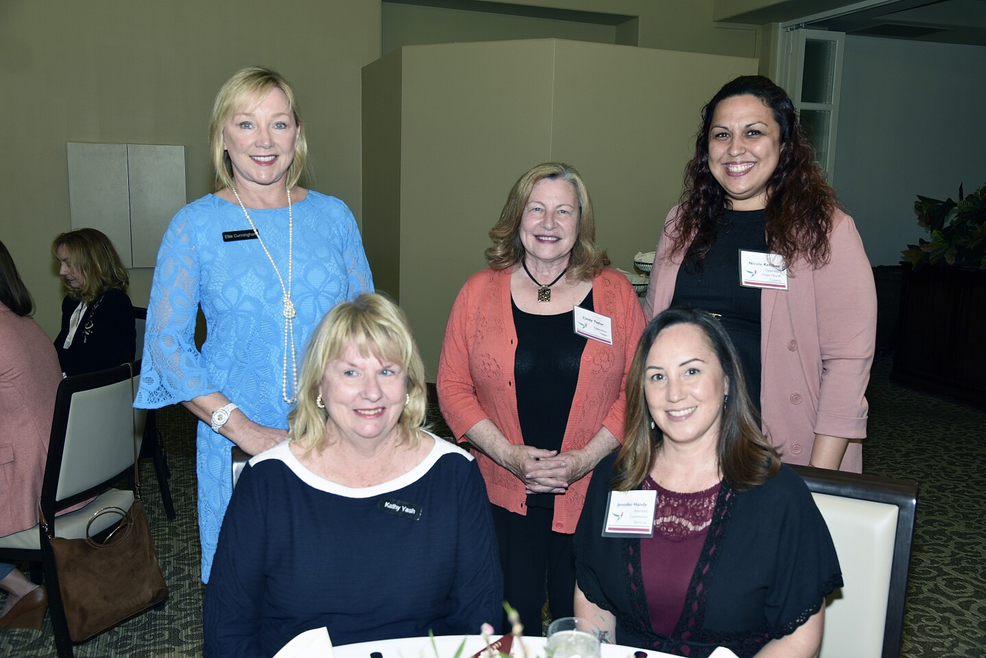 Volunteer Chair Ellie Cunningham, grantee Operation Hope representatives Cindy Taylor and Nicole Ketcher. Seated: Member-at-Large Kathy Yash, Jennifer Handy of grantee Interfaith Community Services