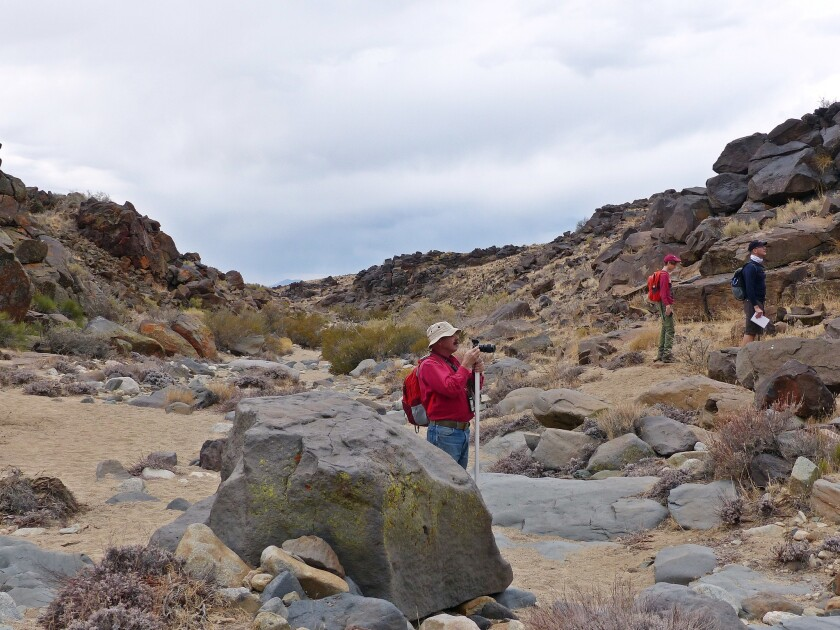 Tour group members explore Little Petroglyph Canyon.