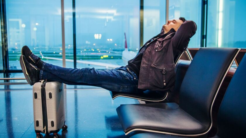 Male Passenger Waiting for His Airplane