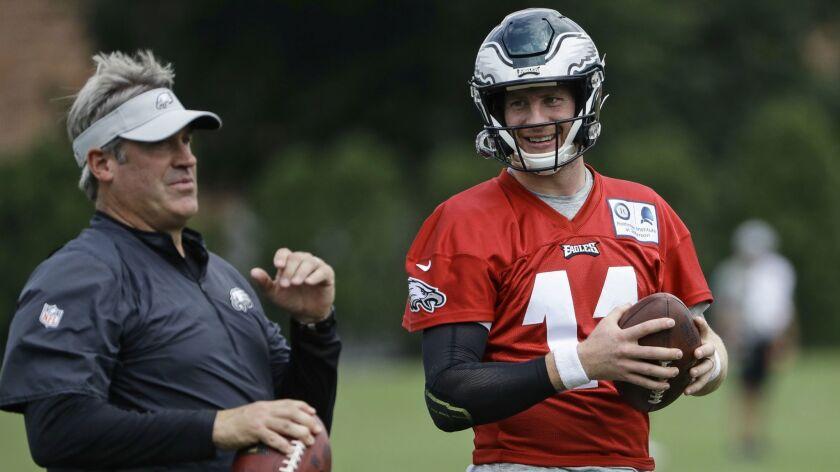 Eagles quarterback Carson Wentz, right, talks with coach Doug Pederson.