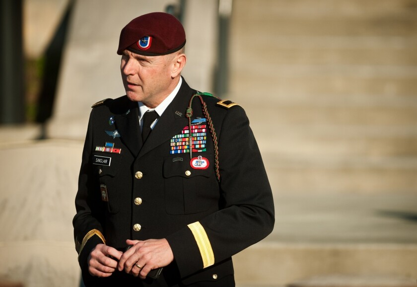 Brig. Gen. Jeffrey A. Sinclair leaves a Ft. Bragg, N.C., courthouse in January 2013. The Army announced he will be demoted two levels in rank after his guilty pleas of sexual misconduct at a court-martial this year.