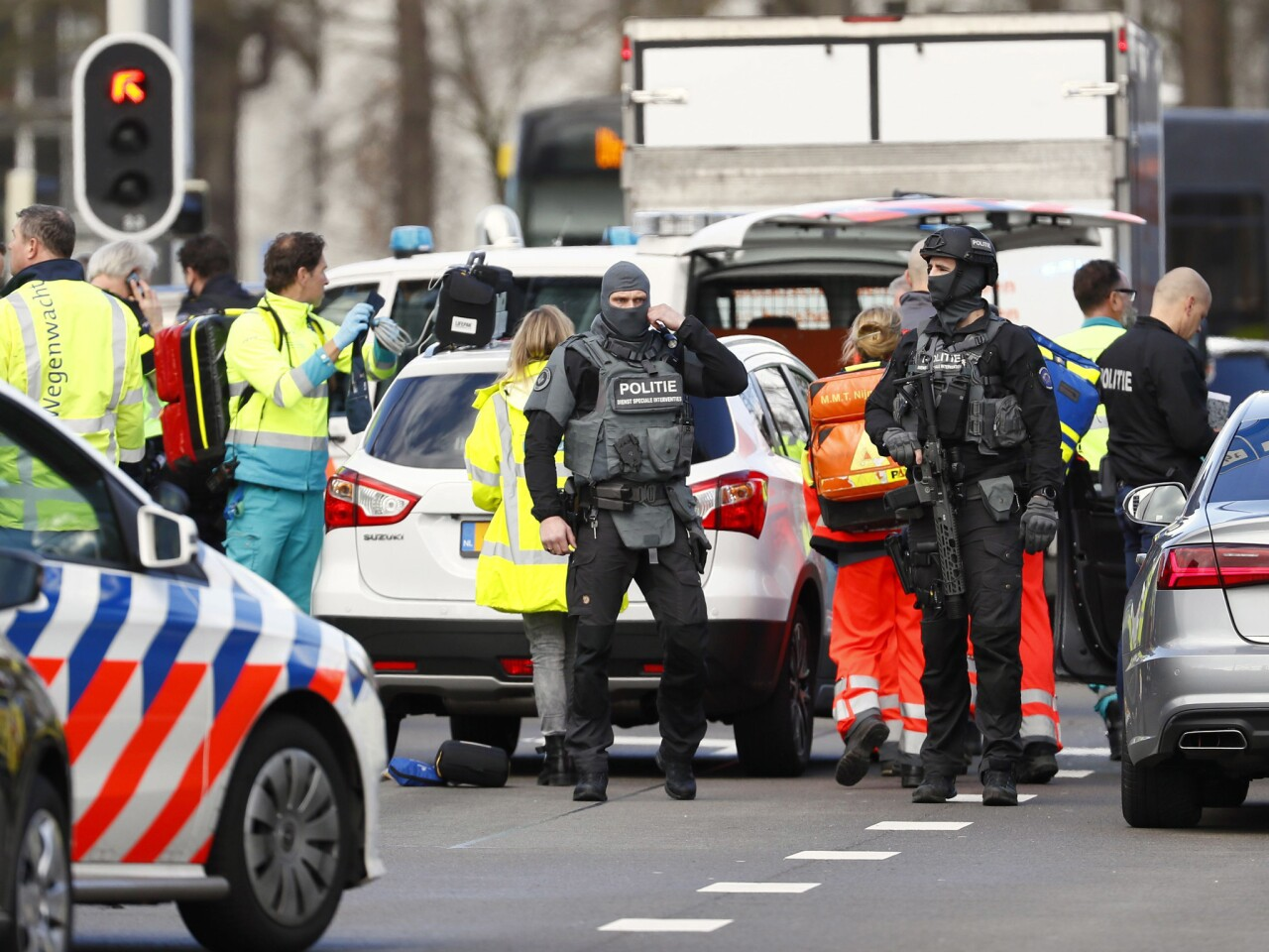 Police and emergency pensonnel at the scene where several people were wounded in a shooting on a tram in the Dutch city of Utrecht.