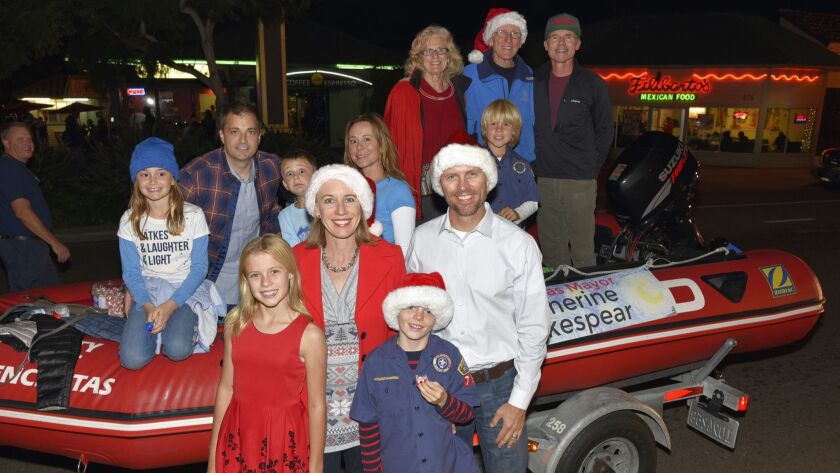 Friends and family join Encinitas Mayor Catherine S. Blakespear, Ava, Oliver, and Jeremy Blakespear