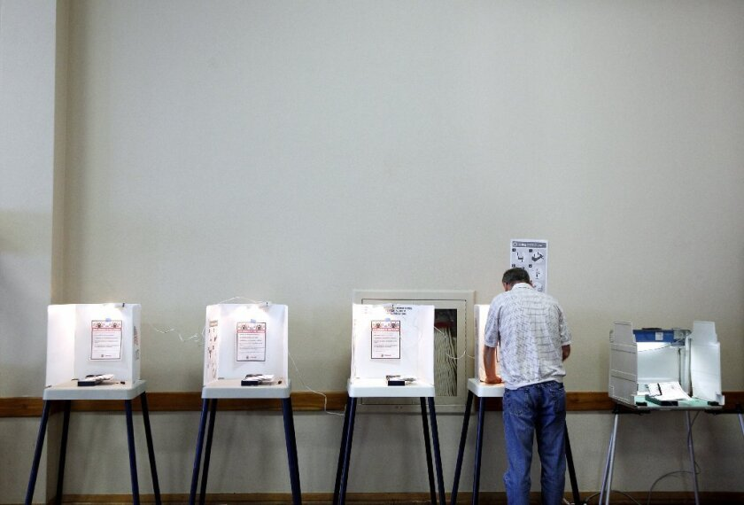 A lone voter fills out his ballot in the June 3 election at the International City Masonic Temple in Long Beach.