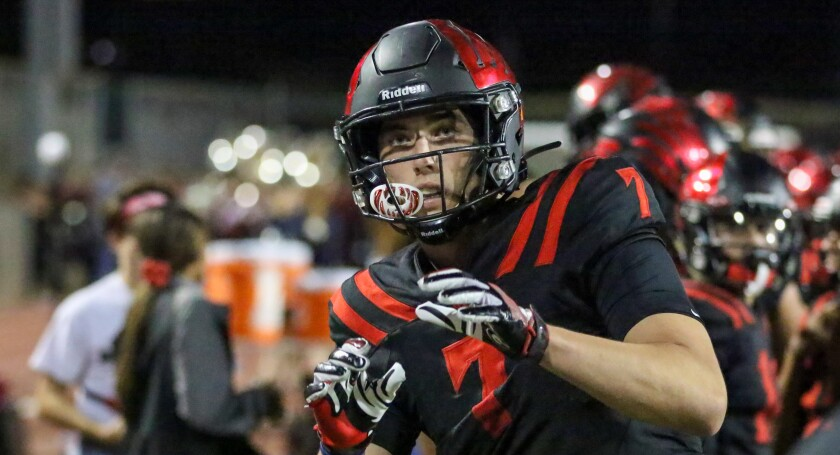 Murrieta Valley tight end Jack Yary warms up on the sideline before the start of the second half against Chaparral on Oct. 3.