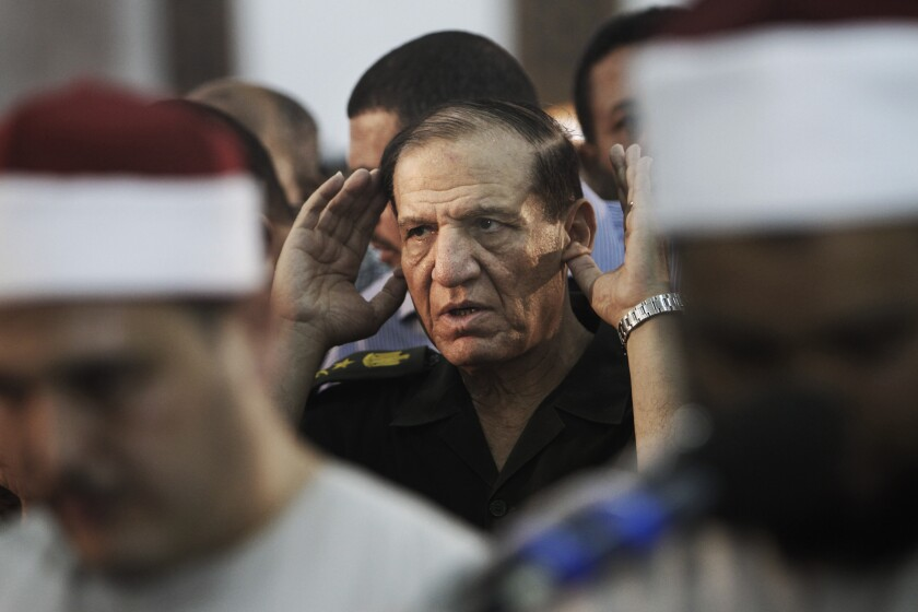 FILE - In this Aug. 5, 2012 file photo, then Egyptian armed forces Chief of Staff, Sami Annan prays for 16 Egyptian soldiers who were killed, in Cairo, Egypt. The Egyptian military on Sunday, Dec. 22, 2019 released Sami Annan, one of the country's former chiefs-of-staff, nearly two years after his arrest following an announcement that he would challenge President Abdel-Fattah el-Sissi in the 2018 presidential vote, military officials and his lawyer said. (AP Photo/Amr Nabil, File)