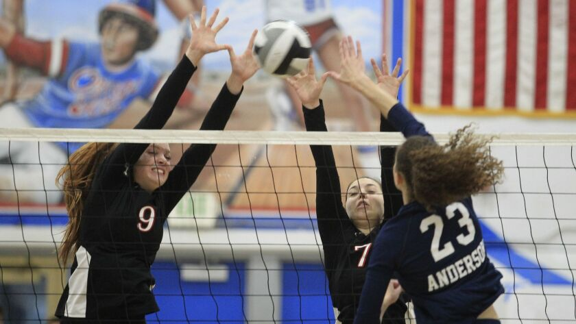 Classical Academy's Chloe Eustis, left, and Kennedy Ragg go up to block a shot by Steele Canyon's Ta