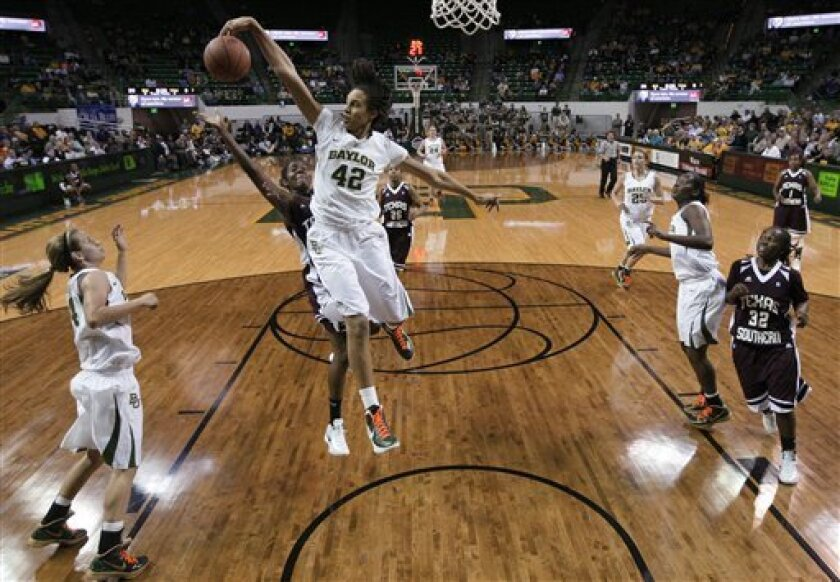 Baylor center Brittney Griner (42) blocks a shot attempt by Texas Southern's Gianne Fleming in the first half of an NCAA college basketball game Wednesday, Nov. 30, 2011, in Waco, Texas. (AP Photo/Tony Gutierrez)