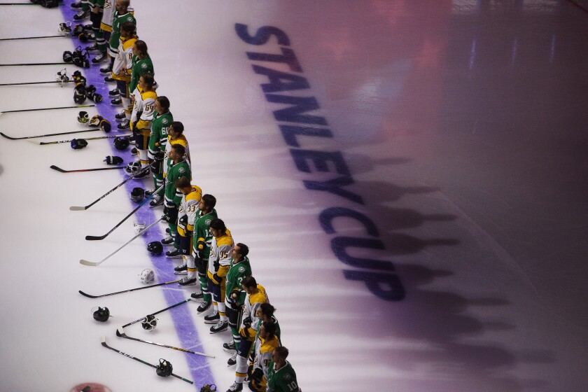 Nashville Predators and the Dallas Stars stand for the national anthem before NHL hockey exhibition game action in Edmonton, Alberta, Thursday, July 30, 2020. (Jason Franson/The Canadian Press via AP)