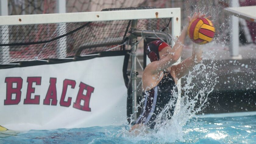 Laguna goalie Quinn Winter stops a shot during nonleague waterpolo against on Friday.