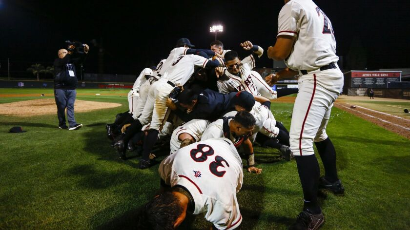 The Aztecs form a dog pile after their 14-5 victory over UNLV in the Mountain West Championship.
