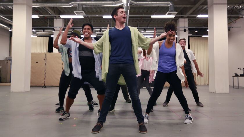 "Matt Doyle and fellow cast members rehearse a scene from ""The Heart of Rock & Roll"" at the Old Globe."