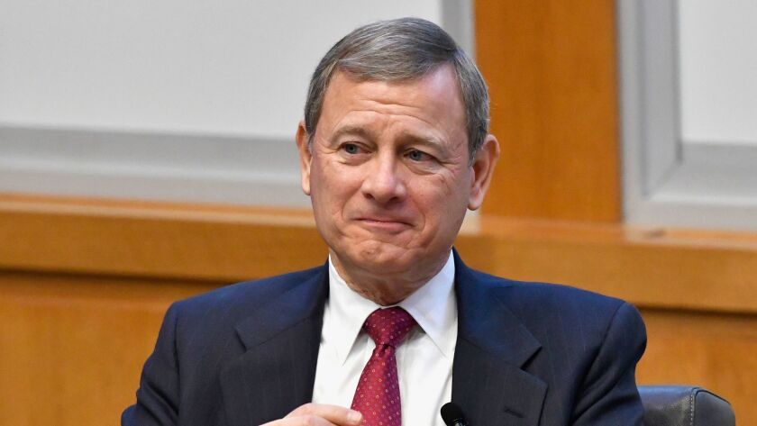 Chief Justice John Roberts prepares to speak at the The John G. Heyburn II Initiative and University