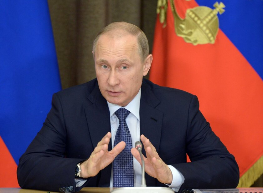 FILE - In this May 12, 2015 file photo, Russian President Vladimir Putin speaks at a meeting with representatives of top military brass and defense industries at the Bocharov Ruchei residence in the Black Sea resort of Sochi, Russia. Putin signed a bill into law Saturday, May 23, 2015, giving prose