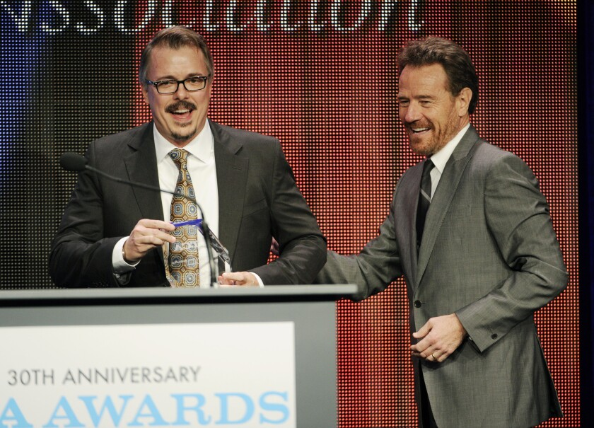 """Vince Gilligan, left, creator and executive producer of the television series """"Breaking Bad,"""" and the show's star Bryan Cranston take the stage to accept the Program of the Year award at the 30th Annual Television Critics Assn. Awards Show at the Beverly Hilton on Saturday in Beverly Hills."""