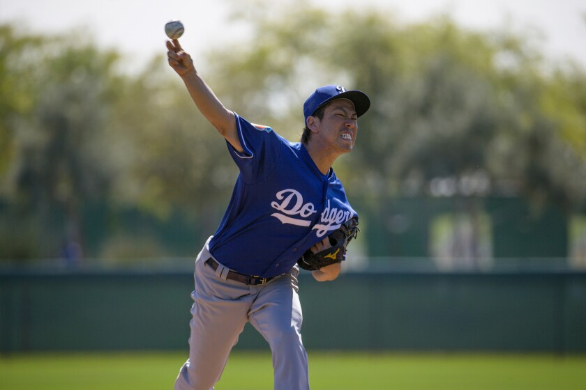 GLENDALE, ARIZONA - FEBRUARY 29, 2016: Dodgers pitcher Kenta Maeda throws live batting practice for the first time to Dodger hitters during spring training on February 29, 2016 in Glendale, Arizona.(Gina Ferazzi / Los Angeles Times)