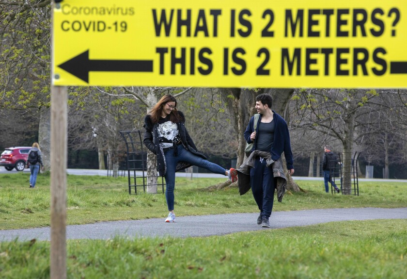In Phoenix Park in Dublin, a sign notifies passers by of the two-meter social distancing measures in place. But what do you do when there is no sign?