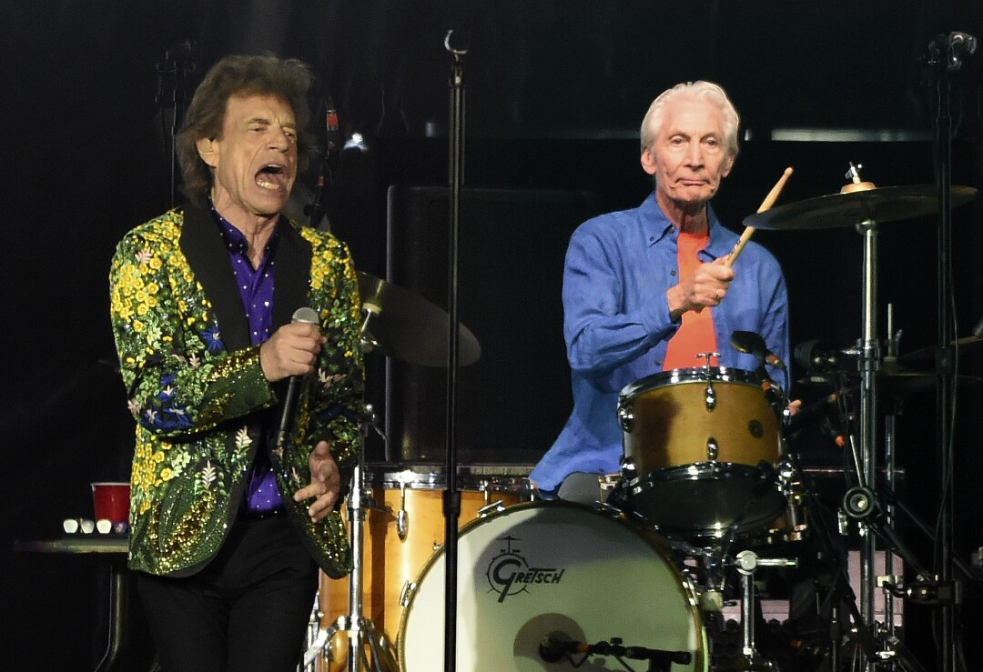 Rolling Stones drummer Charlie Watts, right, performs behind singer Mick Jagger.