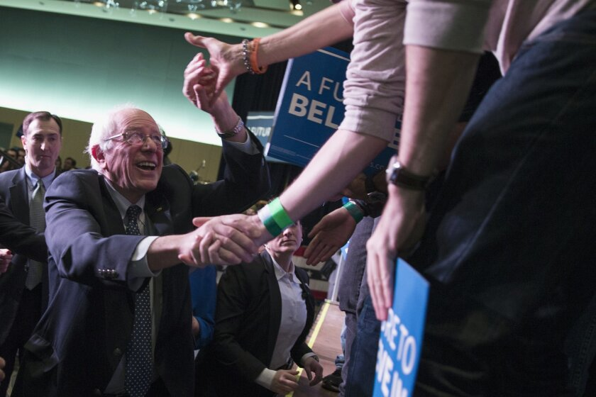 Democratic presidential candidate, Sen. Bernie Sanders, I-Vt. shakes hands during a canvass kick-off event at the Reno Sparks Convention Center, Saturday, Feb. 13, 2016, in Reno, Nev. (AP Photo/Evan Vucci)