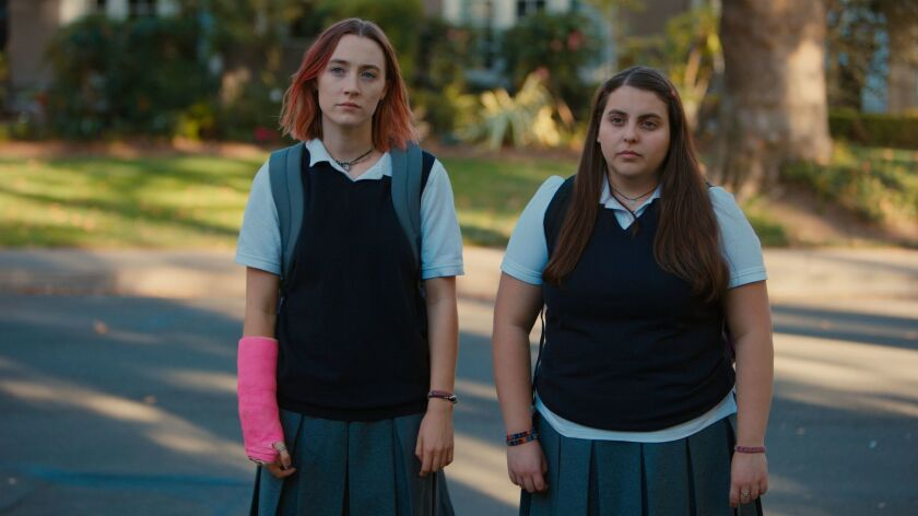 "(L-R)- Saoirse Ronan and Beanie Feldstein in a scene from the movie ""Lady Bird."" Credit: A24"