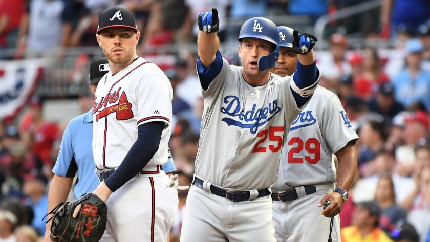 Dodgers' David Freese points to the bench after hitting a two-run single against the Braves in the sixth inning in Game 4 of the NLDS in Atlanta on Oct. 8, 2018.