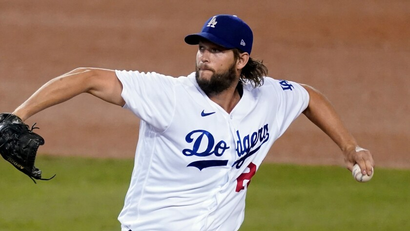 Dodgers starter Clayton Kershaw pitches against the Milwaukee Brewers on Oct. 1 in Los Angeles.