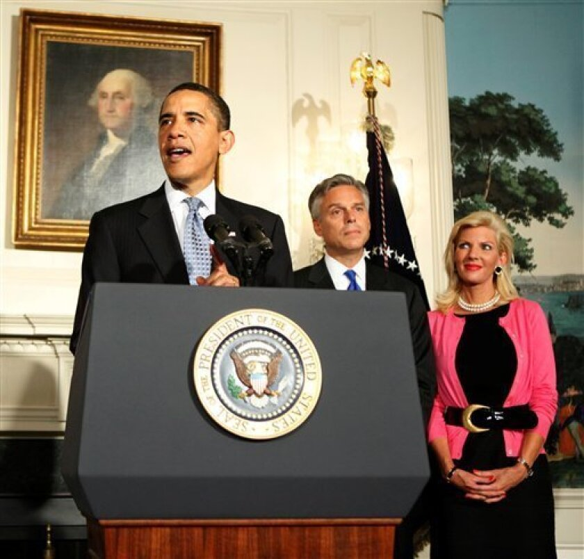 President Barack Obama announces the nomination of Utah Governor Jon Huntsman, center, to U.S. Ambassador to China in the Diplomatic Room at the White House, Saturday, May 16, 2009, in Washington.  At right, Huntsman's wife Mary Kaye Huntsman. (AP Photo/Manuel Balce Ceneta)